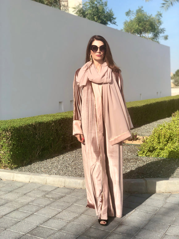 Velvet abaya with crepe satin borders and golden threads. Comes with sheila