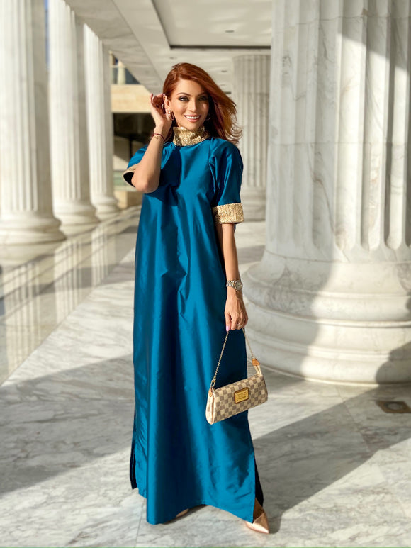 Designed with an embellished-sequin neckline and sleeves, having an A-line silhouette. Comes with separate belt.