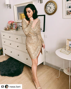 Shimmering Dress is a girl's dream dress. Drenched in gold sequins with slit on the side. This high-voltage dress features a modest, yet elegant silhouette. Fully lined.