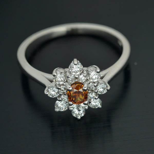 18kt. White Gold Diamond Halo Ring with Fancy Yellow Diamond Cushion Cut