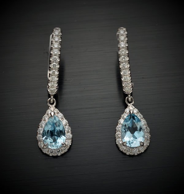 18 kt.  White Gold Aquamarine and Diamond Halo Earrings