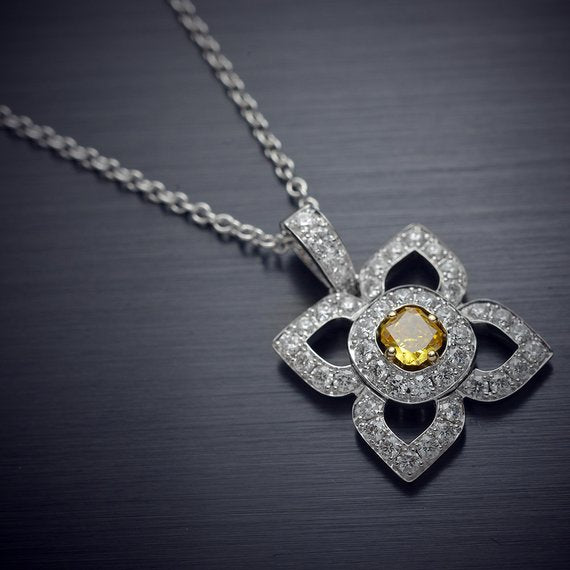18 Karat White Gold Flower Pendant with a Natural Orange Yellow Radiant Center Diamond and Fine White Round Diamond Accents - FlawlessCarat