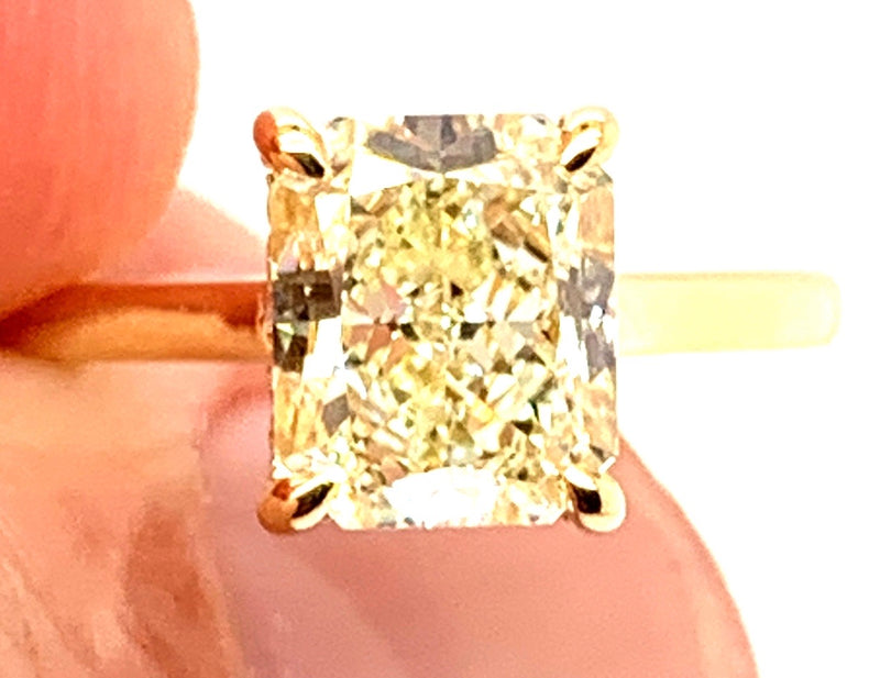 18kt.Yellow Gold Solitaire with Natural Light Yellow Radiant Diamond and Under Halo