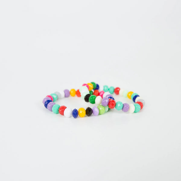 Rainbow bracelets crafted by female refugees displaced in Turkey.
