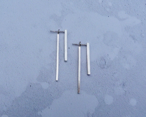 Linear staggered dropper earrings
