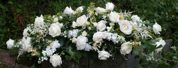 Funeral flowers in a spray