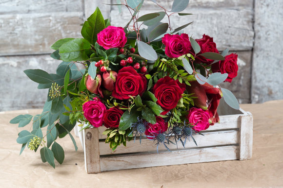 Winter Seasonal Bouquet of reds and Pinks with seasonal foliage