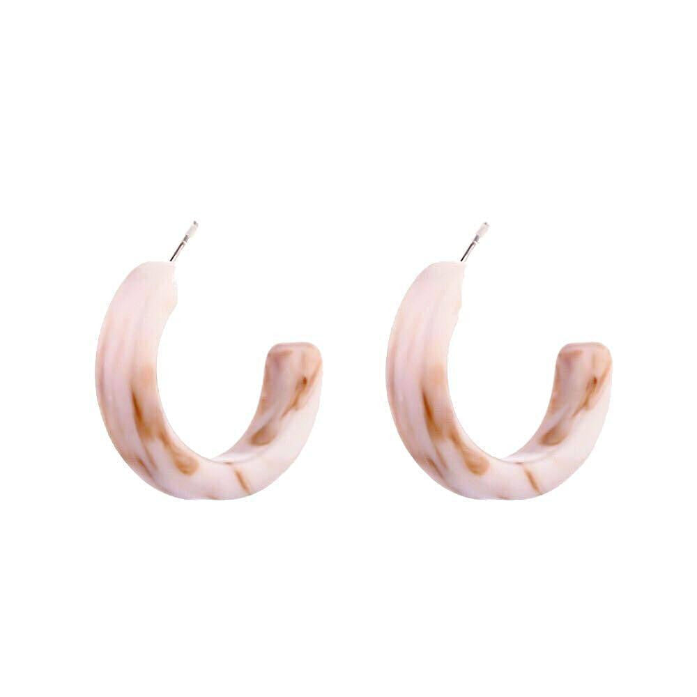 In A Perfect World Pink crescent c shaped resin studs.