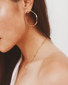 In A Perfect World Irregular skinny hoop stud earring