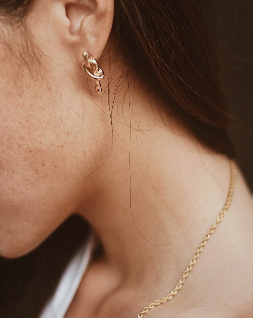 In A Perfect World simple knotted gold stud earring