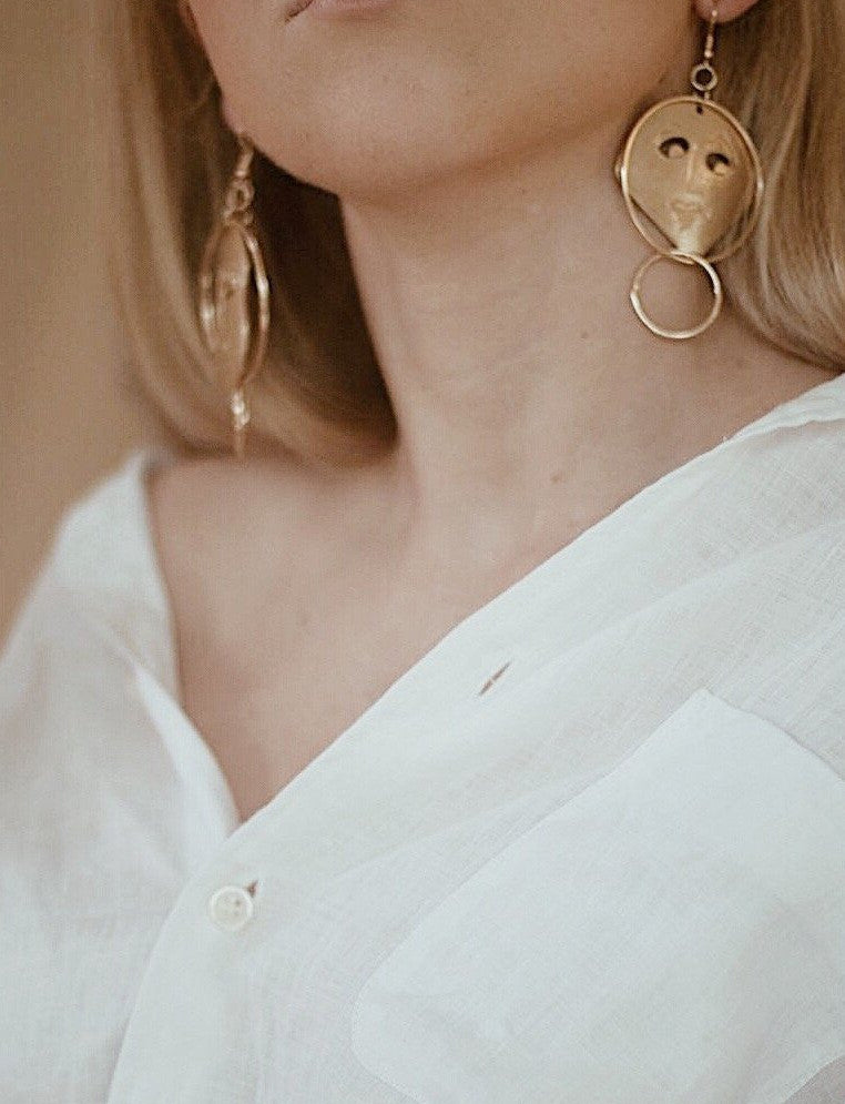 In A Perfect World 8k alloy asymmetric hollow face drop earrings.