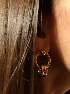 In A Perfect World Asymmetric interlocked rings on rings stud earring