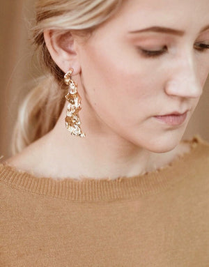 In A Perfect World Hammered gold feather plated earring
