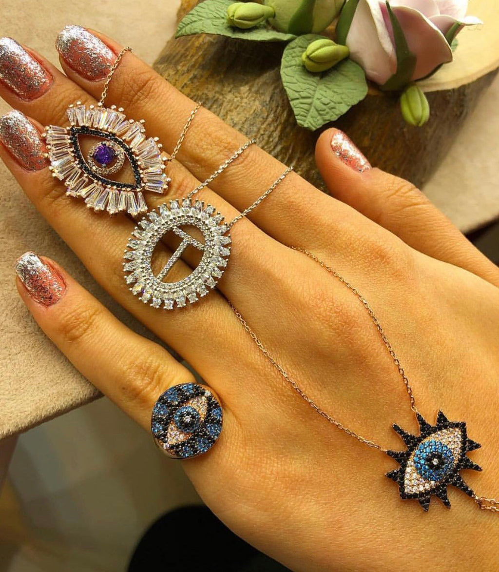 BAGUETTE EYE, INITIAL NECKLACE, NAZAR RING & SHAHMARAN