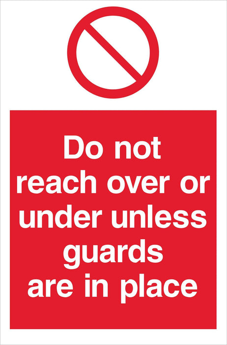 Do not reach over or under unless guards….