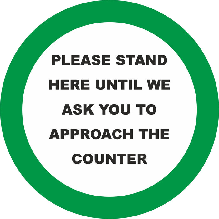 FLOOR STICKER  - PLEASE STAND HERE UNTIL WE ASK YOU TO APPROACH THE COUNTER  - COVID 19 SOCIAL DISTANCING