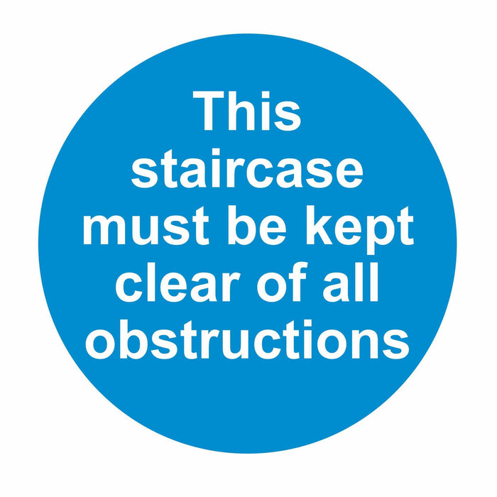 THIS STAIRCASE MUST BE KEPT CLEAR OF ALL OBSTRUCTIONS - SELF ADHESIVE STICKER