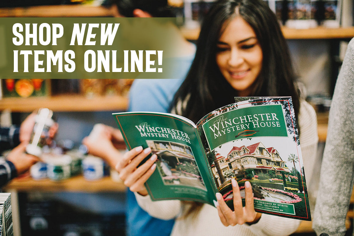 guest reading the official winchester mystery house souvenir book