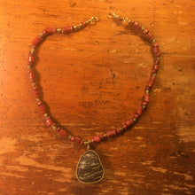 Brass-wrapped Stone with Red Beads