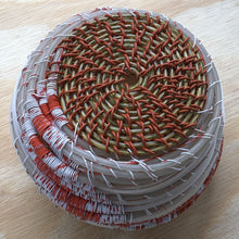white and orange weed whacker wire basket