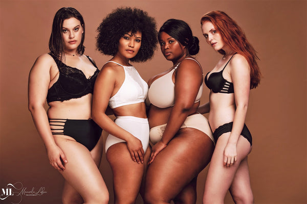 Proud group of women in lingerie posing together | Delicate Beauty