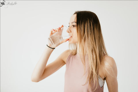 Picture of a woman drinking water