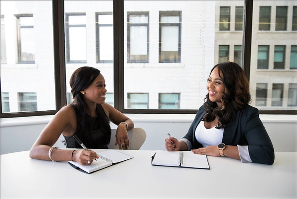 Two black-owned business women discussing ideas | ML Delicate Beauty