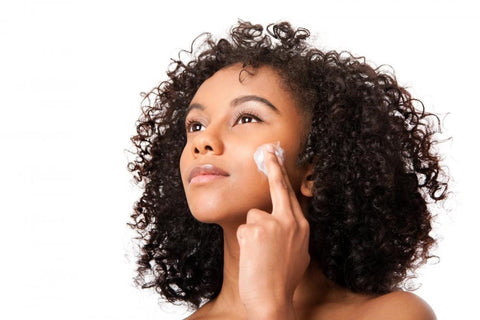 Woman exfoliating her skin using ML Delicate Beauty products