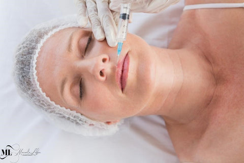 Middle-aged woman receiving Botox | ML Delicate Beauty