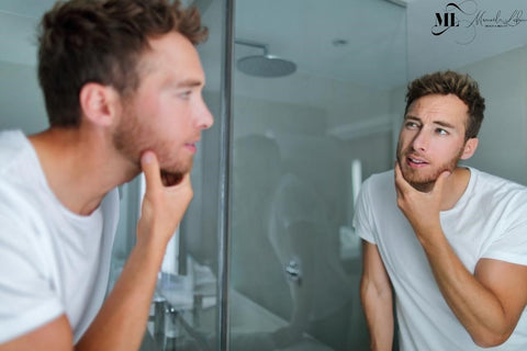 A man using ML Delicate Beauty natural facial skincare products