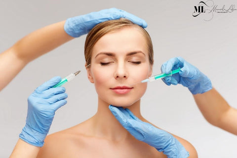 Beauticians giving a woman dermal fillers - ML Delicate Beauty