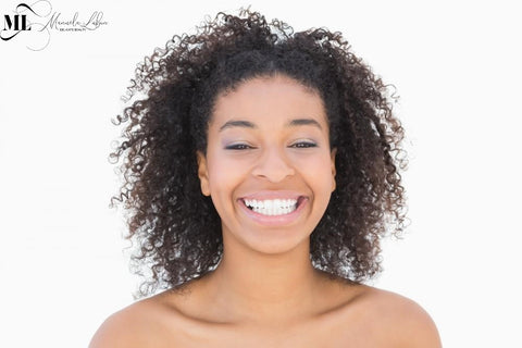 Girl smiling against a white background | ML Delicate Beauty