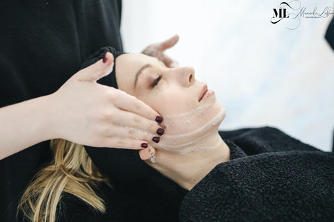 woman getting a face massage - ML Delicate Beauty