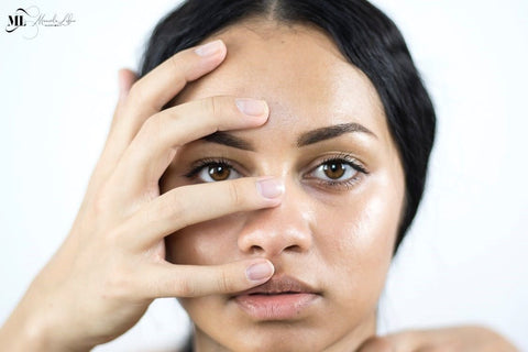 Portrait of a woman Hand covering face | Oily skin products