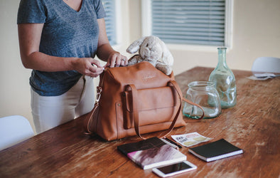 Woman packs her bag with everyday essentials