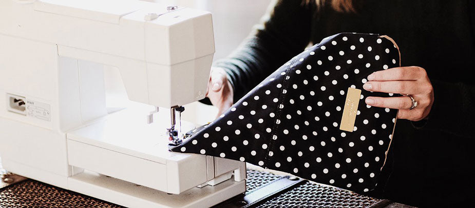 Woman Sews Dotted Diaper Bag on Sewing Machine