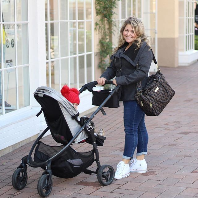 Mom poses with her stroller