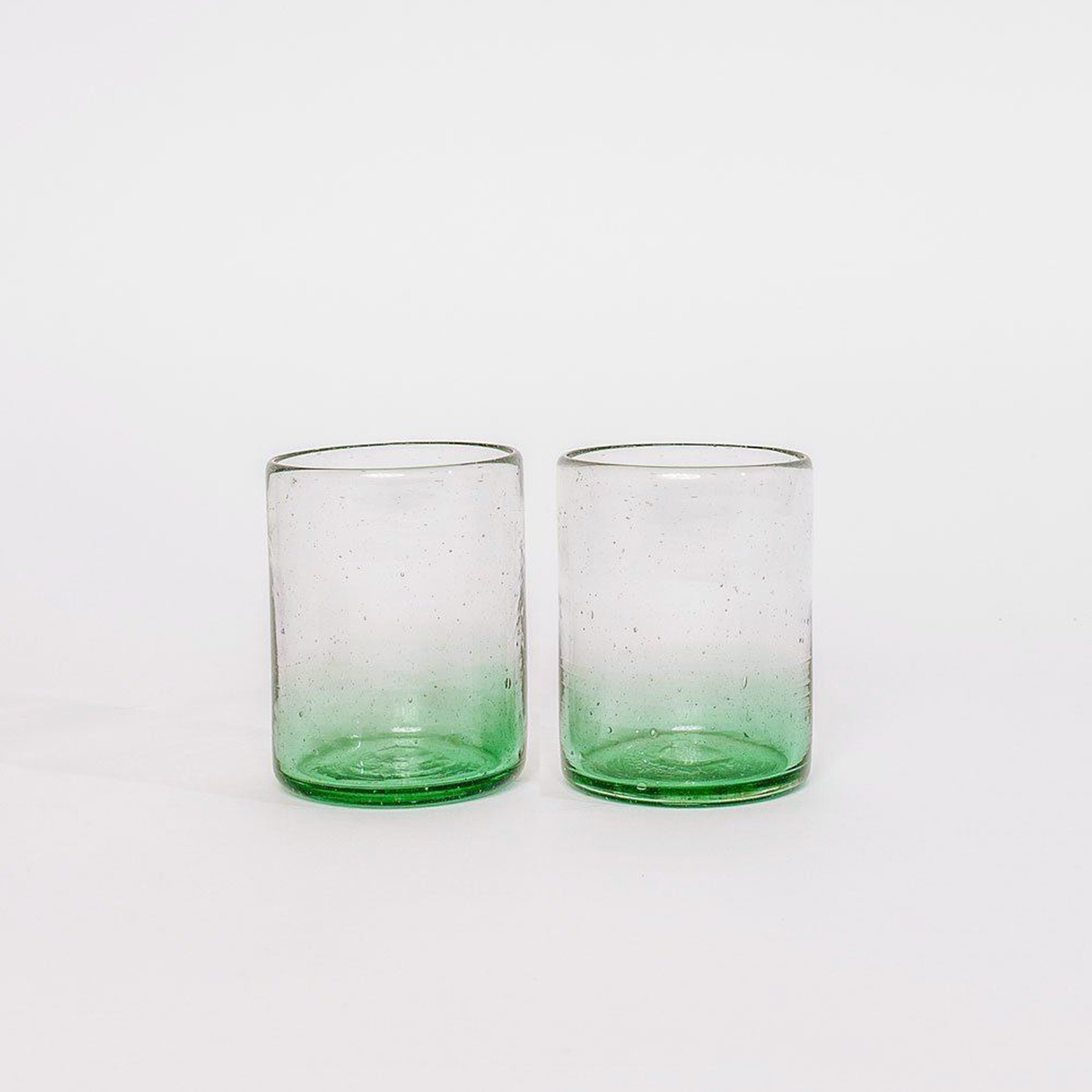 pair of green glass cups