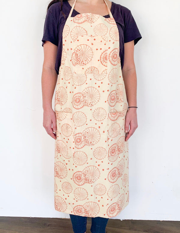 Symbology Dancing Umbrellas + Ginkgo Leaf Reversible Apron in Terra Cotta & Cream Gifts Symbology