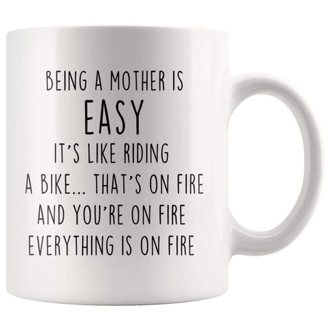 Being A Mother Is Easy. It's Like Riding A Bike... That's On Fire. And Your On Fire. Everything Is On Fire Coffee Mug - BackyardPeaks
