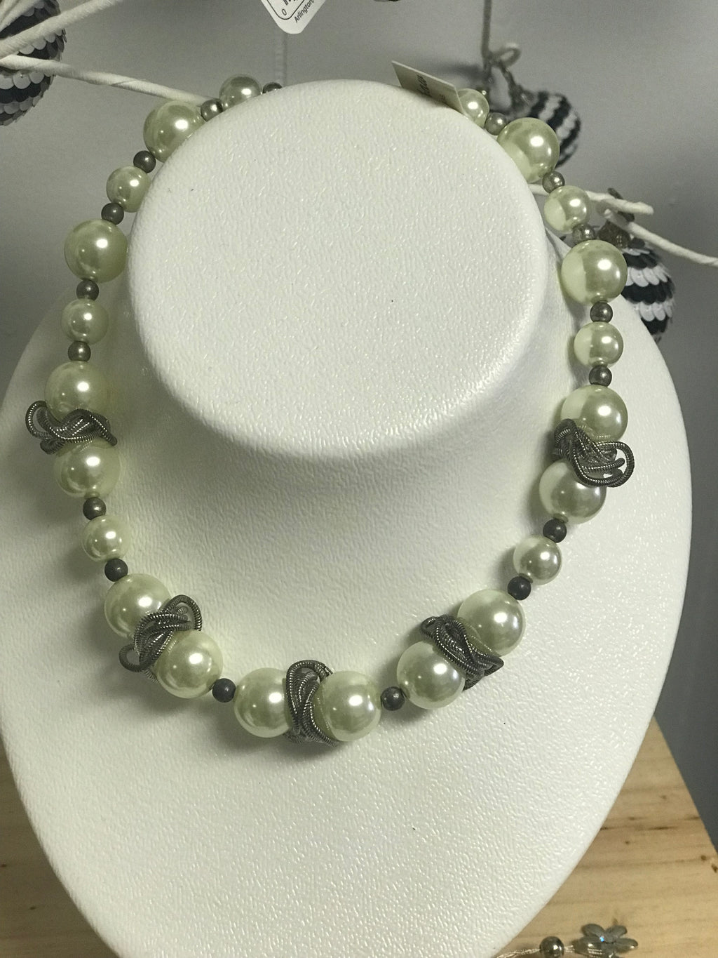Chunky pearl necklace.