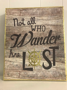 'Not All Who Wander Are Lost' wooden wall decor.