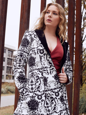 Equestrian themed coat with velvet collar.