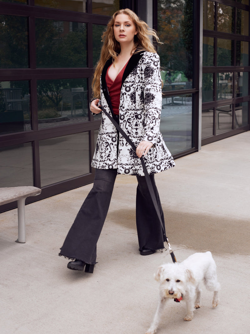 Model wearing contemporary design walking a dog in the city of Atlanta.
