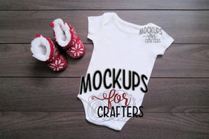 Baby bodysuit mock-up with red slipper booties
