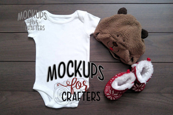 Baby bodysuit mock-up with beaver hat and red slipper booties
