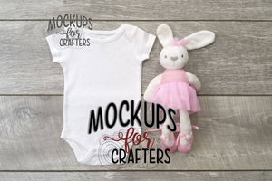 Baby bodysuit with adorable ballerina bunny accessory