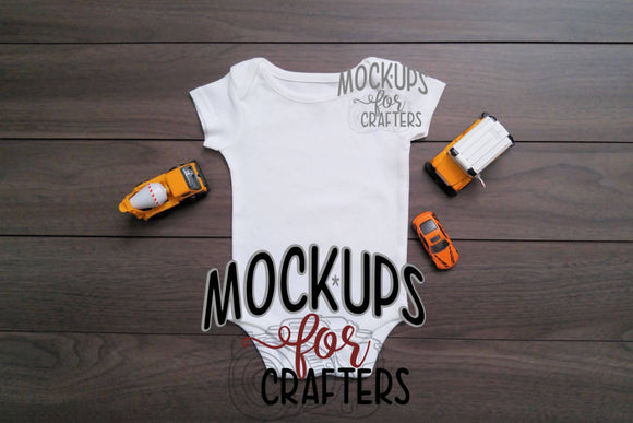 Baby bodysuit mock-up with toy cars accessories