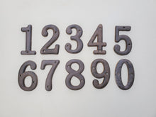 Small Iron Numbers