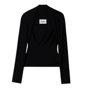"Black long sleeved shirt with an angular neckline with a white ""Nanushka"" label. Top is against a white background."